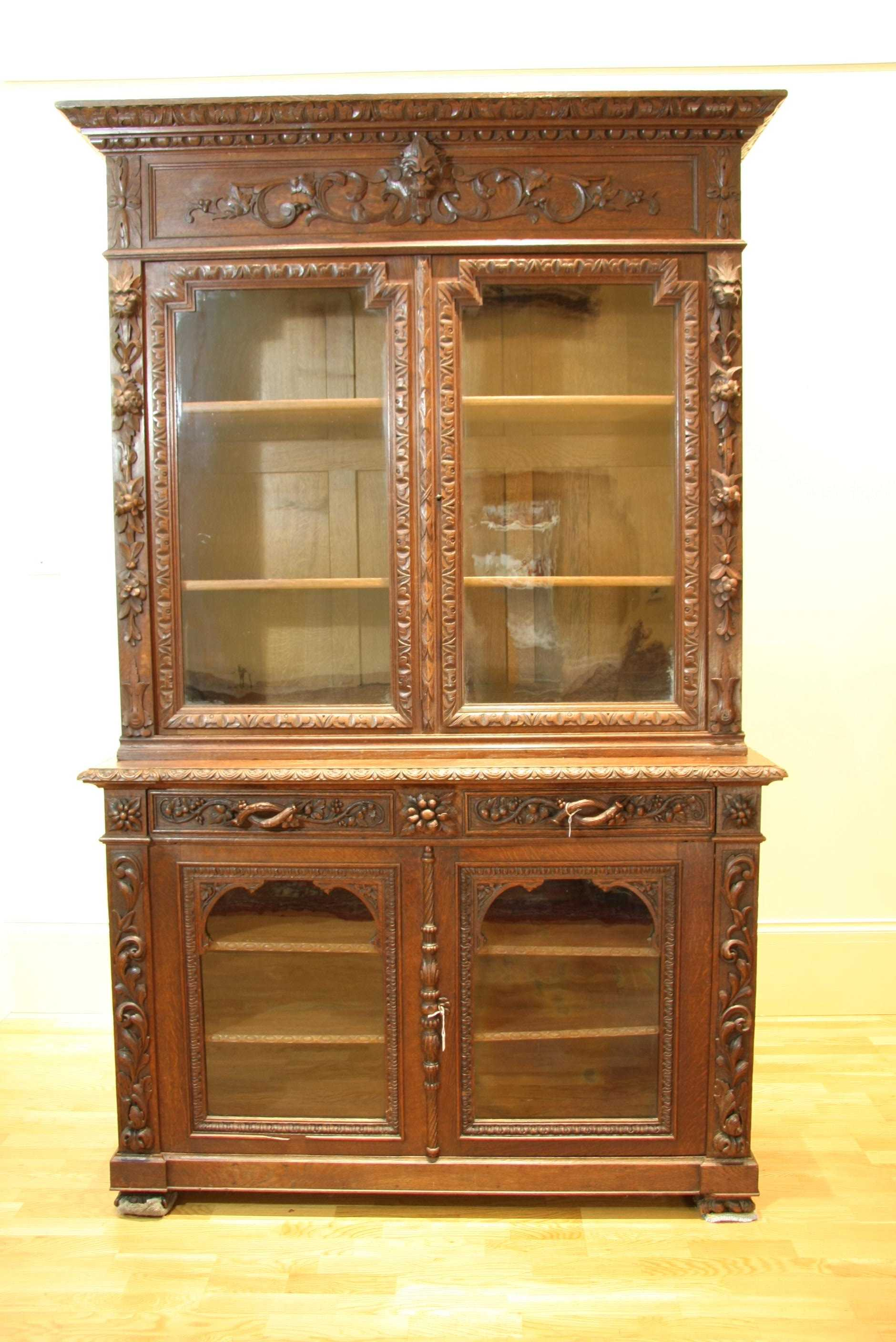 large oak bookcase with a and decorative arts
